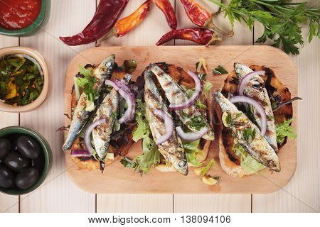 Italian crostini sandwich with sardine gish, onion and lettuce