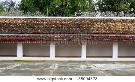 Long Corridor And Walkway With Layering Of Roof