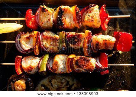 Freshly Grilled skewers of salmon and vegetables. BBQ kebab