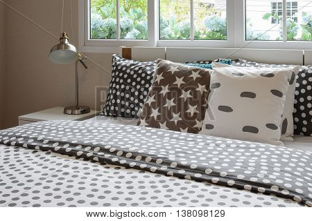 Bedroom Interior Design With Polka Dot Pillows On Bed And Decora