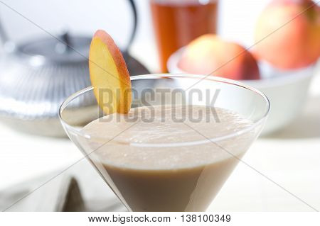 Delicious and fresh peach smoothie with tea
