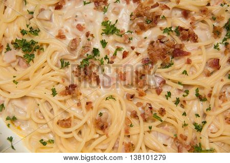 Spaghetti alla carbonara with parmesan cheese and bacon