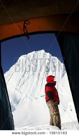 Climber on background Alpamayo peak