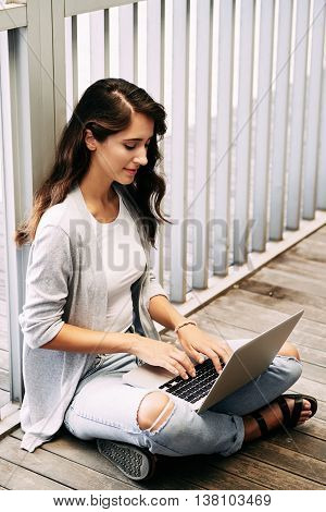 Portrait of copywriter busy with work on laptop