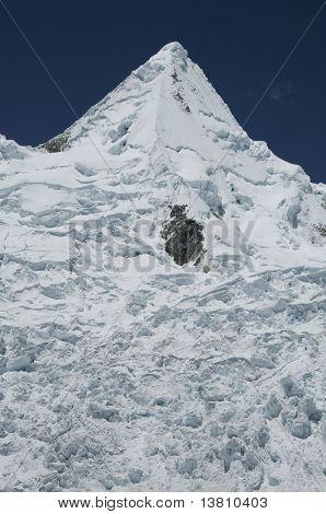 Snowy peak Alpamayo in Cordilleras