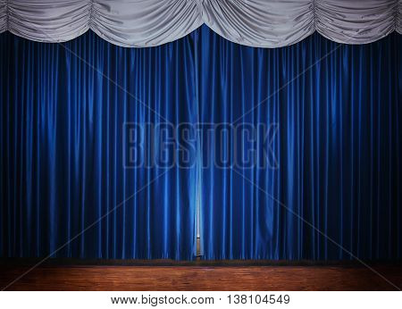 wood theater stage with blue silver curtain