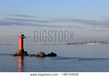 lighthouse in the sea, calm sea on a day