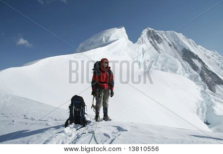 Climber standing on the summit