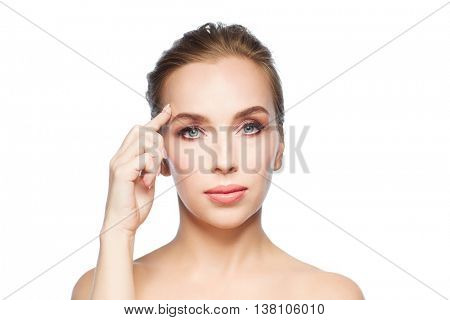 beauty, people and plastic surgery concept - beautiful young woman showing her forehead over white background