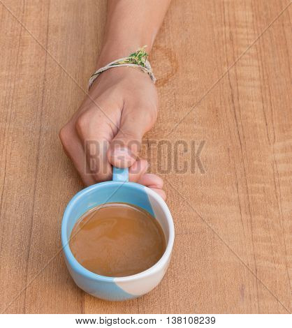 Coffee hand no wooden table background, Top view