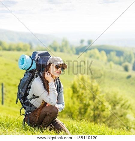 Young Backpacking Woman Rest At The Hill