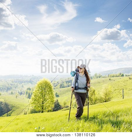 Young Hiking Woman Standing On The Top Of The Hill