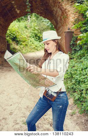 Female Tourist With Map Sightseening Arch Bridge