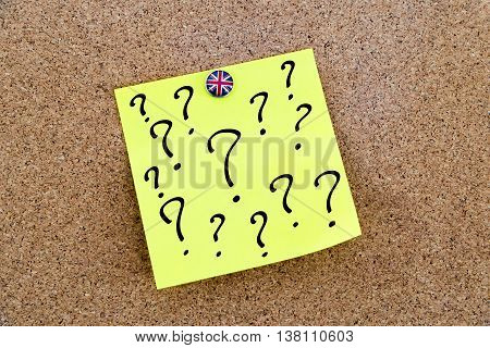 Yellow Paper Note Pinned With Great Britain Flag Thumbtack And Question Marks