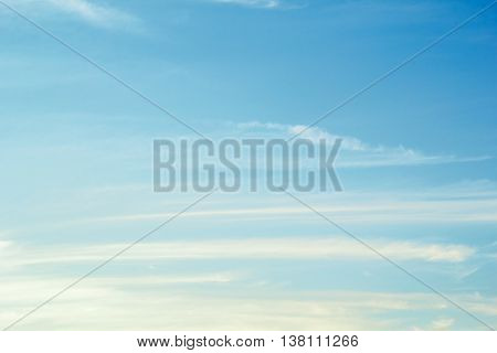 Landscape with light cirrus white clouds in the blue sky