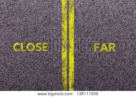 Tarmac background with the words close and far