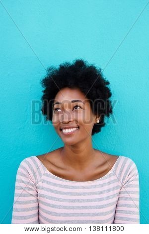 Beautiful Young African Woman Smiling With A Glance