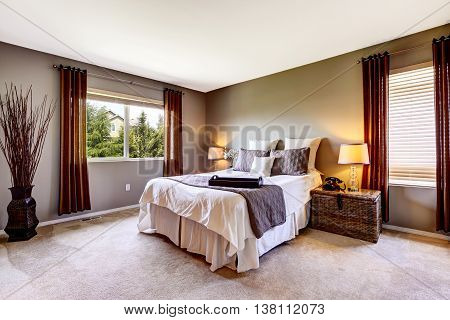 Bedroom Interior With Carpet Floor And Big Bed