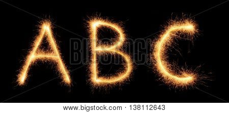 Abc Lettering Drawn With Bengali Sparkles Isolated On Black