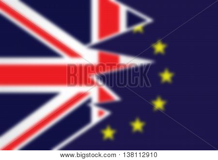Blurred background flag United Kingdom exit from the European Union resulting from the June 2016 referendum with the Union Jack and European Union flags splitting apart