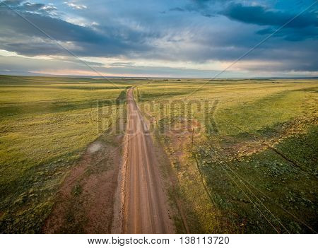 ranch road over prairie in southern Wyoming near Colorado border - aerial view