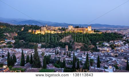 Wide angle of Granada and the ancient arabic fortress of Alhambra at dusk. Spain.