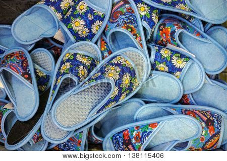 Colorful heap of house slippers in market