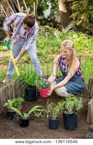Young gardeners planting at botanical garden