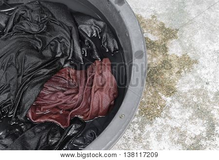 Soak dirty clothes in the basin black for clean,Thailand washing clothes style ancient