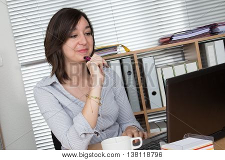 Portrait Of Businesswoman With Laptop Writes On A Document
