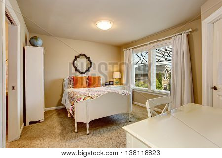 American Antique Bedroom Interior With White Desk And Orange Pillows On The Bed.