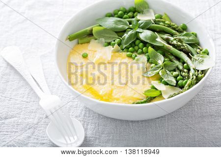 Cheesy polenta with plenty of green vegetables and parmesan