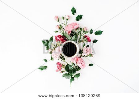 Cup of coffee with pink roses and flowers. Flat lay top view