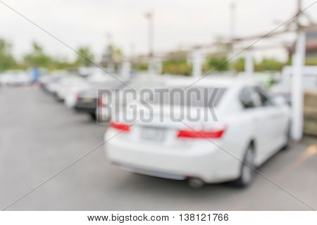 Blurred abstract photo of full outdoor car park background.