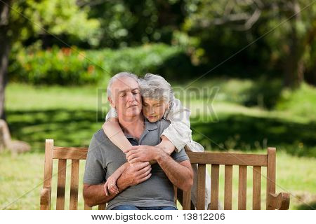 Mature Couple Hugging In The Garden