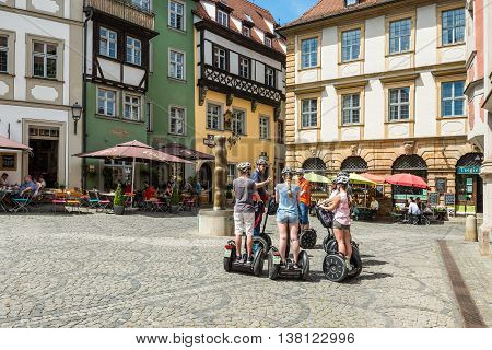 Bamberg Germany - May 22 2016: Tourists on segways visiting Bamberg old town Pfahlplatzchen square in Upper Franconia Bavaria Germany. Scenes of tourist activities in a popular travel destination.