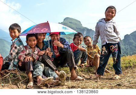 YEN BAI, VIETNAM, September 25, 2015 Hmong ethnic group of children, frolic in the rice fields, the harvest season