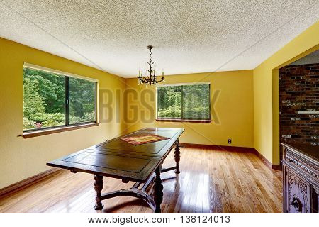 Empty Dining Room With Antique Furniture And Hardwood Floor