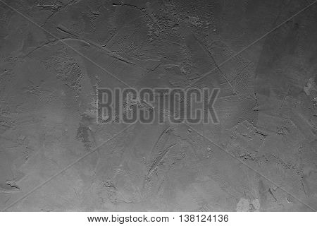 Texturized grey putty with gradient light. Vintage or grungy background of venetian stucco texture as pattern wall. Horizontal view