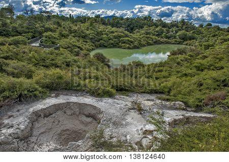 The bathing waters of Hatupatu near Whakarewarewa Geyser at Te Pui thermal park in geothermal valley of Rotorua New Zealand
