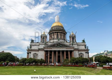Saint Petersburg, Russia - 10 July : St. Isaac Cathedral Built in 1818-1858 years by architect Auguste Montferrand. Tourists take pictures of local attractions the days of military glory of Russia on 10 July, 2016.
