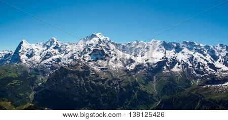 The Jungfrau Monch Eiger panorama view from the top of Shilthorn Switzerland.
