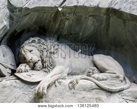 Lewendenkmal the lion monument landmark in Lucerne Switzerland. It was carved on the cliff to honor the Swiss Guards of Louis XVI of France.