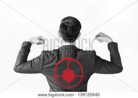 Strong Businessman Flexing His Muscle With Red Target On His Back