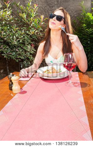 Lady With Sun Glasses Enjoying Lunch On Terrace