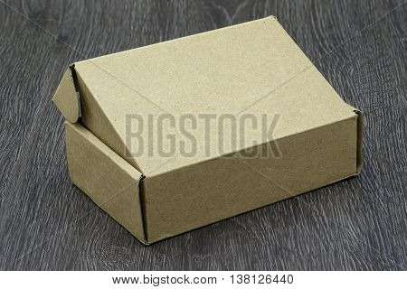 background, blank, board, box, brown, cardboard, carton, case, closed, container, copy, craft, deliver, delivery, design, desk, distribution, empty, food, gift, mock, nature, nobody, old, order, pack, package, packaging, paper, paperboard, parcel, party,