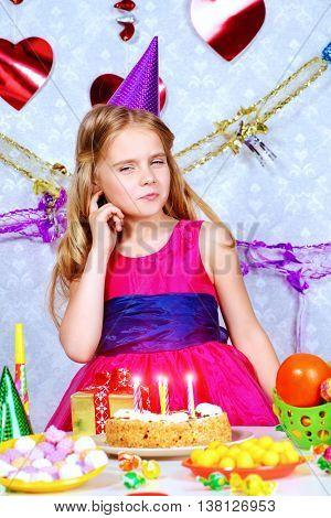 Beautiful little girl enjoys her birthday. Celebration, life events. Happy birthday.