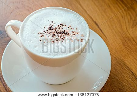 Cappuccino with cinnamon on a decorative background