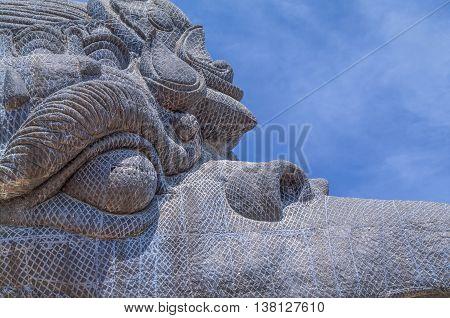 close up of Garuda face statue in GWK cultural park Bali Indonesia