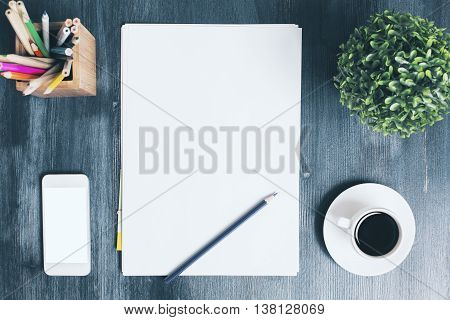 Top view of wooden office desktop with blank white smart phone empty paper sheet coffee cup decorative plant and pencils. Mock up